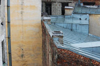 roofs of old brick houses, covered with galvanized sheets. Saint-Petersburg, Russia.