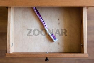 modern toothbrush in open drawer