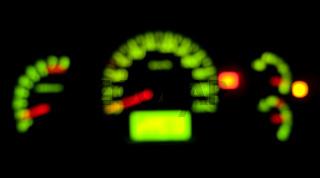 Car dashboard indicator illuminated at night