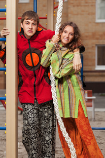 Happy young fashion hippie couple on the playground
