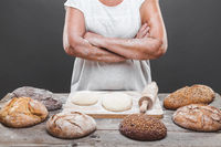 Baker preparing a variety delicious fresh bread and pastry