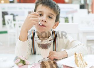 Child eat milk choco shake