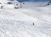 Skier downhill on ski slope