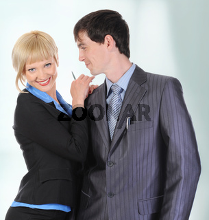Beautiful blonde woman hugging a man in the suit.