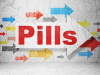 Medicine concept: arrow with Pills on grunge wall background