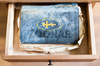 old ritual book in open drawer