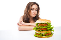Healthy woman rejecting junk food isolated