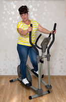 woman exercising on trainer ellipsoid