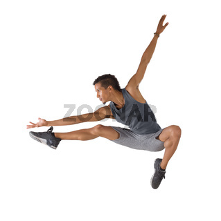 Young man jumping isolated on white