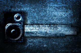 Musical grunge background with speaker.