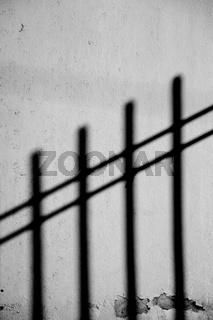 Zaun wirft Schatten