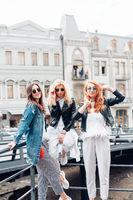 three beautiful girls on the street