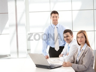 Successful businessteam smiling happily