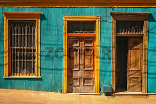 Wooden doors to old tenement house in Valparaiso
