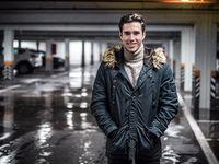 Confident man in underground car parking