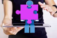 Person with tablet pc and puzzle piece