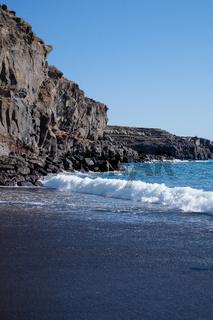 beautiful wild beach with black sand