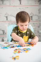 Little boy playing puzzle