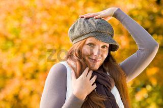 Autumn park - long red hair woman fashion
