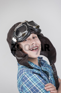 Boy with leather Cap folded arms