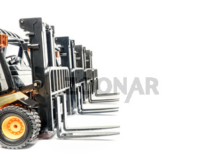Four forklift trucks parked in a row shot on white background