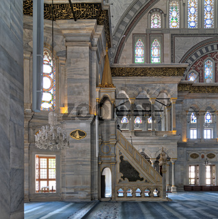 Interior shot of Nuruosmaniye Mosque with minbar (platform), arches  colored stained glass windows, Istanbul, Turkey