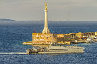 Boat Passing The  Statue of The  Golden Madonna, Messina Italy
