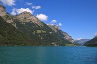 Turquoise lake Klontalersee in summer. Landscape in Glarus canton.
