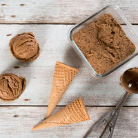 Top view cocoa ice cream scoops