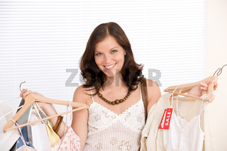 Fashion shopping - Happy woman choose sale clothes