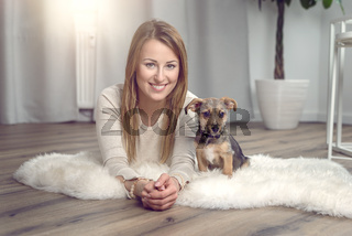 Attractive friendly woman with her dog