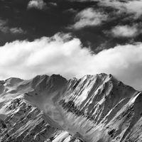 Black and white snow winter mountains and sunlight cloud sky in evening