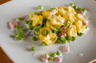 Tortellini with cream ham and peas