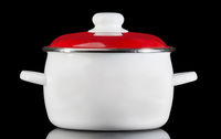 White saucepan, isolated on black background.