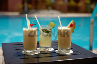 Cocktails of Mojito and Pina Colada on Wooden Table Near the Swimming Pool During Summer