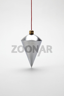 Vertical plumb on white background