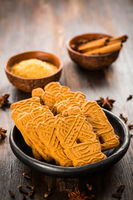 Christmas gingerberad cookies with spices on wooden table
