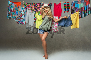 beautiful happy girl dancing on laundry background