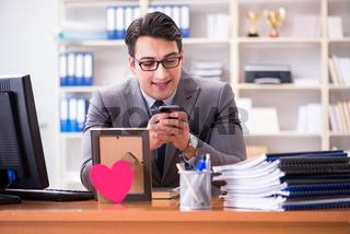 Businessman in saint valentine concept in office