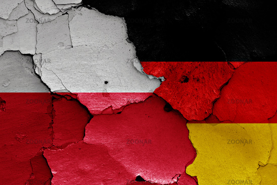 flags of Poland and Germany painted on cracked wall