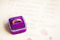 Wedding invitations and vintage ring in the velvet box