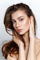 beautiful girl with natural makeup and long hair