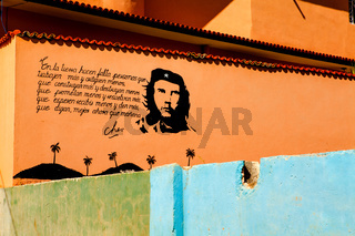 Painting of Che Guevara on a old wall in Trinidad