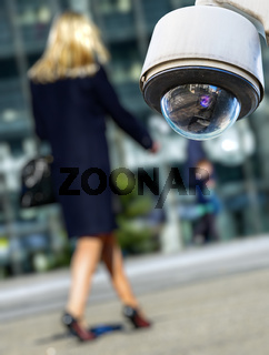 security CCTV camera or surveillance system with woman on blurry background