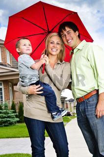 Happy family with umbrella