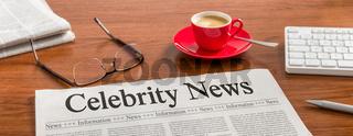 A newspaper on a wooden desk - Celebrity News