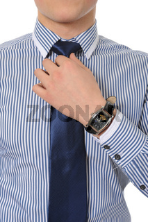 picture of a business man adjusting his tie