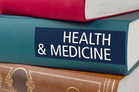 A book with the title Health and Medicine written on the spine