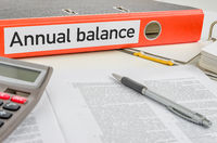 An orange folder with the label Annual balance