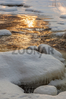 Snow and ice in the river